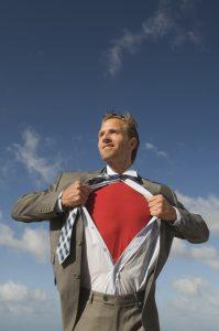 Smiling Superhero Businessman Outdoors Blue Sky Red Shirt