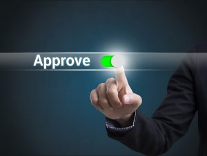 Businessman hand pressing button approve. sign on virtual screen. business success concept.